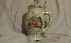 """Avon Collectible """"Salute to the Postal Service Stein."""" With box. Featuring the Pony Express on the front and the 1st postmaster Benjamin Franklin on the back. #52203."""
