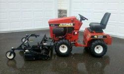 18 HP Owen eng. with very low hours. Bucket and plow blade included. Great condition! Call 612-310-8479 for more info.