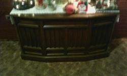 stereo with radio and record player. radio works well. record player needs a needle. cabinet in good condition.