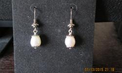 Fresh water tear drop geniune pearl sterling silver earrings selling 8am - 6pm no shipping cash only.