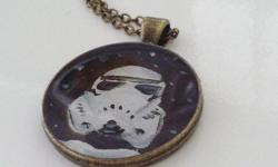 """An original acrylic painting of a stormtrooper placed inside of a necklace and sealed with resin. Necklace measures 18"""" and is one of a kind. This necklace contains original painting and not a print. Can be purchased through etsy by clicking link."""