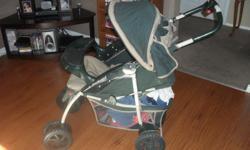 Eddie Baur stroller with car seat. Item has been used but is clean.