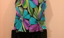 New without tags Robbylen Ladies Swimsuit Size 16 Two-Piece with skirt. Lower cut neckline and back with built-in soft cup bra for confortable support. If interested can be shipped for flat rate of $6.80.