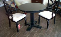 Very nice Black wood table with 2 arm chairs. Set is left over from a staged condo. No damage or stains. Table set is the same in the picture. Asking $200.00. Call or text me at 678-979-7046