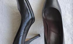 Originally $175 +/- Womens black leather pumps. Barely worn. No tears or scratches. Size 7.5 Will negotiate.