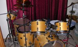 I have an eithe piece drum set with all hardware. It also has two booming cymbal stands and a custom madeGucci stick bag. The set includes one pair of Tama sticks. This a beautiful set with newish Evans hydro studio heads. It also comes with a Tama