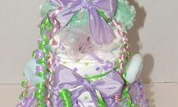Teddy Bear 2 tier diaper cake baby shower gift centerpiece Cake Contains: 15-20 size 1 pampers diapers 2 receiving blankets 2 wash clothes 2 spoons 1 pacifier 1 pair of socks 4-5Johnson'sbaby care products (shampoo,lotion etc....