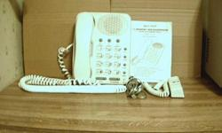Lennox Telephone 13-Button Memory With Hold Button.Instruction Manual Included. Works Good! Has A Long Cord.$10.00 And $12.50 Shipping.