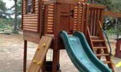 The Logamate Playscape $3,095 - Price includes delivery and setup - Sales Tax is not included - Rent To Own - $155.11 for 36 months with $310.22 Deposit. Log Cabin Style Playhouse with Swing Set- Unit comes with wooden playset system- Safety Grip Belt