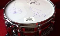 The Police signed Stewart Copeland Snare drum. This is pre reunion tour RARE RARE RARE!!!! All Members signed this piece. Comes with photographs and certificate of authenticity. Wonderful example of Police memorabilia.