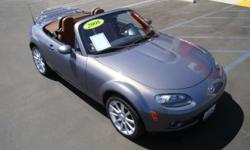 "You could call this ""San Diego on Wheels"", you could call it ""A Dream Convertible"", you could also call it ""Mine""! This beautiful Miata MX-5 Touring is in a class all its own, from the dark Adobe-colored leather to brown soft top to the sporty 6-speed"