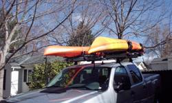 Thule Hullavator rack system - Complete Hullavator 897XT set up for two kayaks - Hullavator system new over $1600 - sell for $700 - like new used 4 trips () -. Note: kayaks in photo are for illustration purposes only. They have been sold.