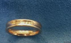 Beautiful Tiffany & Co. NY 1837 Rubedo Ring Size 6 1/2. I have a Tiffany case that is a little wornand I am throwing it in at no additional cost. It fits the ring well.