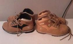 2 pair of Timberland boots kids size 2.5. In new condition, hardly ever worn. Call or text at