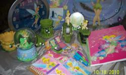 Tinkerbell office accessories, stapler, tape dispenser, post it pad holder, paperclip holder, pencil holder. Also, Notebooks, pocket folder and markers. Clock, night light Minature ink pads with several stamps and tinkerbell musical glass globe, plays Fur