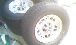 "Tires are like new,custom rims fitford Ranger.size 70/14"""