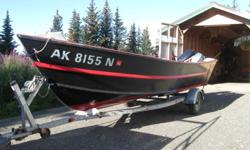 20' Tolman skiff    2013 50 HP Evinrude E-Tec outboard: Oil injection, 3 gals/hr; low hours; electric start, power trim and tilt 9.9 HP Yamaha kicker Extra gas tank and oars 2013 King