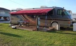 THIS IS ONE BEAUTIFUL MOTORHOME. IT IS A 36 FOOT..DIESEL (CUMMINS 270) THE FRONT SEATS ARE NEW BOTH IN WHITE LEATHER WITH LOTS OF CONTROLS. HAS 101,000 MILES. ..2 FLAT SCREEN TV'S ..NEW PAINT GRAPHICS..NEW CONVECTION OVEN. SHOWER
