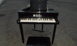 kids toy piano styled after a baby grand . german made well built good condition