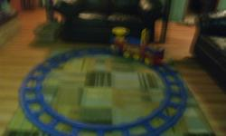 blue and red drivable train set with battery charger