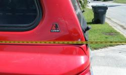 Red Truck Topper.....is on our 2006 Dodge Dakota Truck....comes with key to lock it up