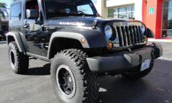 Jet black; lifted; huge tires; custom rims; v6 3.8 - and that's just the outside! This is a true Rubicon for true Rubicon fans! Step up inside this beast and enjoy your multi-disc mp3 player, hands-free bluetooth tech, A/C, cruise control, power