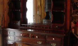 Two piece, dark pine dresser, with mirror. Good condition. See picture