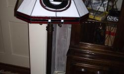Stained glass floor lamp with Georgia insignia on globe. Measures 57 inches tall, 16 inch globe. Genuine leaded stained glass, antique gold stand on base, officially licensed Georgia stained glass floor lamp. Great gift for the bedroom or office. Comes