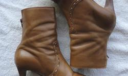 Originally $150 +/- Womens leather mid-calf boots with heels. Zippered. Barely worn. No tears or scratches. Size 7.5 Will negotiate.