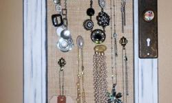 Unique, hand-made jewelry organizer. Jewelry NOT included. Materials: Acrylic paint; Upcycled vintage frame (solid wood); vintage hardware/knob; cork board; natural burlap. Thanks, Marie  Visit my website: