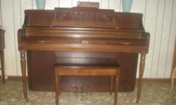 One owner, cherry finish upright piano with bench. Excellent condition, in Batesville, MS