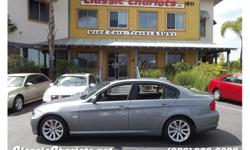USED 2011 BMW 328i PREMIUM PACKAGE!Drive comfortably with dual power seats, dual climate control, AM/FM/CD stereo, power locks, windows and mirrors, cruise control, a digital info center, moonroof and the convenience of in-dash navigation. Drive