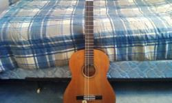 I'm selling a Yamaha CG-111C classical guitar. It has a cedar top, nato back, sides, and neck, rosewood fretboard and bridge, and 19 frets. It has a good tone, although the strings will need changed, because the tuning doesn't seem to hold 100%, but the