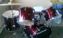 Used Ludwig Drum set for sale made in China. Deep Red color. Asking Price $450.00.