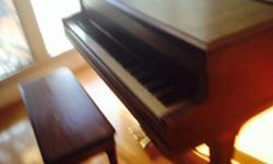 Conover baby grand piano and bench. Very good condition