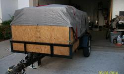 4 feet by 8 feet (4x8) Utility trailer manual winch manual winch tilt bed 12 inch tires new spare  call 269-720-1089