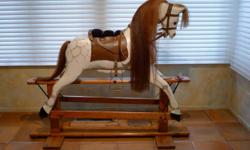 """Made by Collinson in England, restored there, shipped to California 1992, have all correspondence, shipping paperwork, customs antique declaration. Dimensions: to top of neck, 46"""", nose to rump 33"""". Swingstand 54"""" long by 18"""" wide."""