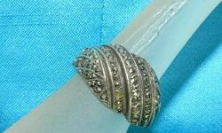 This 1920's vintage ring is stunning. The setting is sterling silver with approximately 60 marcasites hand set in a swirl pattern. It is hallmarked 929 sterling silver and signed with the maker's initials. This is a beautiful and simple
