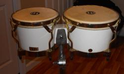 selling vintage lp fiberglass bongos.comes with stand and hard carrying case