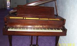 This would be the perfect piano for a beginner, church or choir. Packard was known for making quality pianos, and was founded in 1871 in Fort Wayne, Indiana. Fine craftsmanship. Built with American pride. This baby grand piano has seen many a church