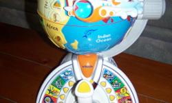 COST $160.00. LIKE NEW. WIRELESS JOYSTICK REMOTE CONTROL. 7 MODES OF PLAY. TEACHES BASIC FOREIGN LANGUAGE PHRASES. INTRODUCES CHILDREN TO WORLD GEOGRAPHY, PEOPLE, AND PLACES. 4 YRS AND UP. SEVEN FLIGHT MISSIONS AND MORE. LEARN ABOUT CONTINENTS, OCEONS,