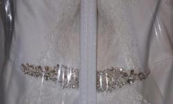 Sweetheart cut with corset back, lace trim (ivory). Size 16 =14 in regular clothing.
