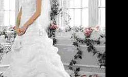 This Wedding Gown is from David's bridal, It has a lace up back so it will fit sizes 8 to about a 12. It was origionally $599.oo on sale, before tax, beautiful pick up skirt, chapel train, organza all over,a lot of beaded sparkle, worn once and GORGEOUS!