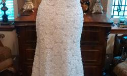 I'm a local Fashion Designer. The wedding gowns shown are from repurposed and vintage fabrics. The price range is from $250 to $500.00. I have 6 other gowns not shown. If your interested in seeing them I can send a jpg attachment of the photos.