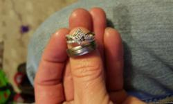 Have a mans size 9 titanium ring for $50.00 and a womens size 7. 14k white gold diamond ring that has been sautered together but also can be resized if need for $350.00
