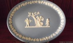 This is a Wedgewood Oval Platter in Blue Jasper 9 1/2in across and 7 1/2in tall. It is in excellent condition and comes with a holder. A great classic gift for the holidays.