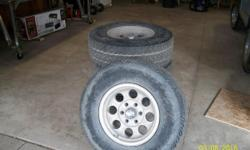 Set of 4 265/76R16 Load range E4 on chevy 6 hole aluminum rims