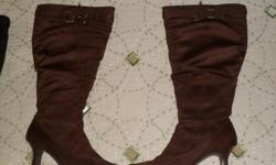 I HAVE 2 PAIR , COLORS ARE CHOC.BROWN AND BLACK, EXCELLENT COND. WORN ONCE,PAID 100.00, WOULD LIKE 50.00 EACHPLEASE CALL -- Size 8
