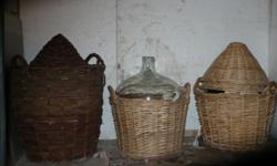 Four demijohns with wicker basket. Each demijohn holds 40-45 liters. $25 each or 2 for $45.