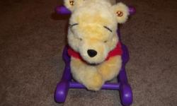 THIS WINNIE THE POOH ROCKING TOY IS SIMOLY WINNIE ON A ROCKER. IT PLAYS SEVERAL MUSICAL NUSERY RHYMES BY THE PUCSH OF EITHER EAR... IT'S NOT NEW BUT IN GREAT SHAPE.... THANK YOU FOR YOUR INTEREST!!